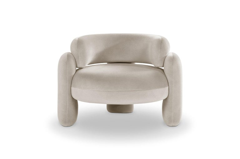 Embrace armchair by Royal Stranger Dimensions: 96 x 85 x 68 cm Different upholstery colors and finishes are available.  Materials: Velvet  Featuring an enfolding composition of geometrical shapes, the Embrace Armchair will cozy you up in a