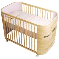 Embrace Dreams Crib in Beechwood and Cotton Candy Pink by MISK Nursery