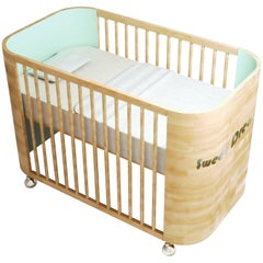 Embrace Dreams Crib in Beechwood and Light Celadon Green by MISK Nursery