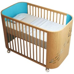 Embrace Luck Crib in Beech Wood & Turquoise by Misk Nursery