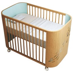 Embrace Luck Crib in Beechwood and Sky Blue by Misk Nursery