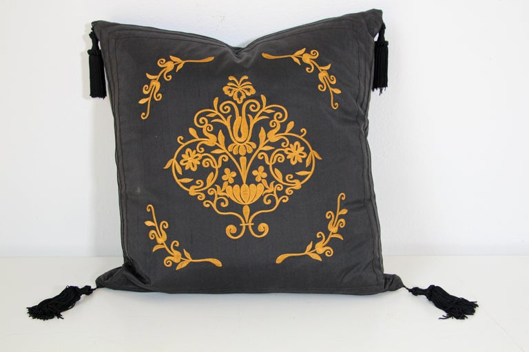 Black silk decorative accent throw pillow with tassels.