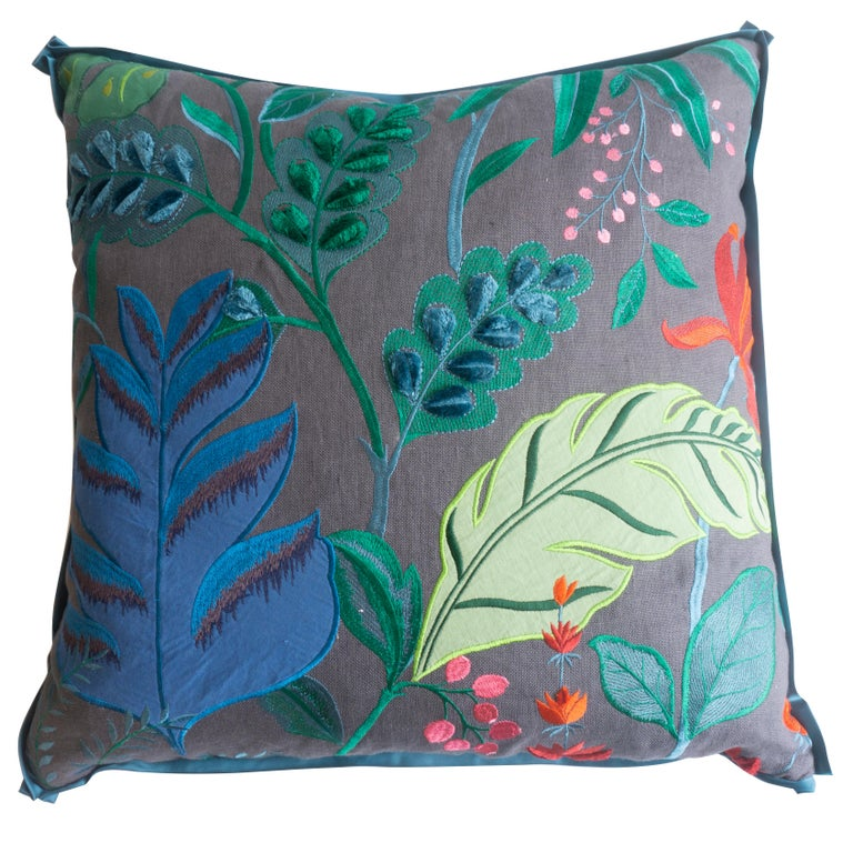 Hand sewn at our studio in Norwalk, Connecticut, these throw pillows feature a designer linen fabric embroidered with tropical flora. The back of the pillows are covered in a silk blue fabric. They are bordered with a small flange trim with neatly