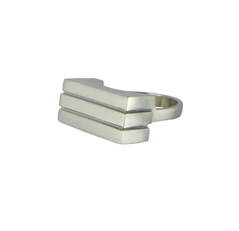 The three tiered sculptural ring is architectural by design and simplistic in appearance.   Designed and created in Dublin, Ireland.