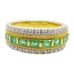Emerald 0.68 Carat with Diamond 0.26 Carat Ring Set in 18 Karat Gold Settings
