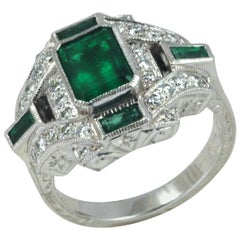 Emerald 1.66 Carat, Emerald 0.33 Carat, Diamond 0.37 Carat Ring in 18 Karat Gold