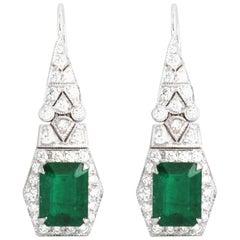Emerald 3.42 Carat with Diamond 0.88 Carat Earrings Set in 18 Karat White Gold