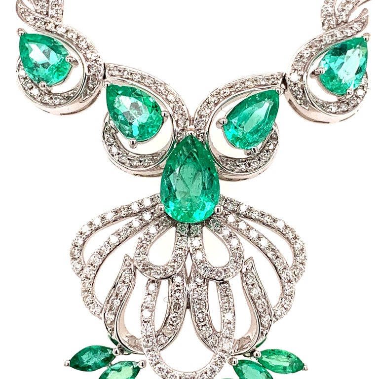 Elegant emerald diamond necklace. Lively green, high luster, pear, marquise faceted, 5.17 carats emeralds mounted in high profile open basket, accented with round brilliant cut diamonds. Handcrafted design set in high polished 14 karat white gold