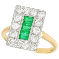 Emerald and 1.33 Carat Diamond Yellow Gold Cocktail Ring