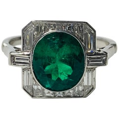 Emerald and Baguette Diamond Engagement Ring in Platinum