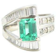 Emerald and Baguette Diamonds Platinum Ring
