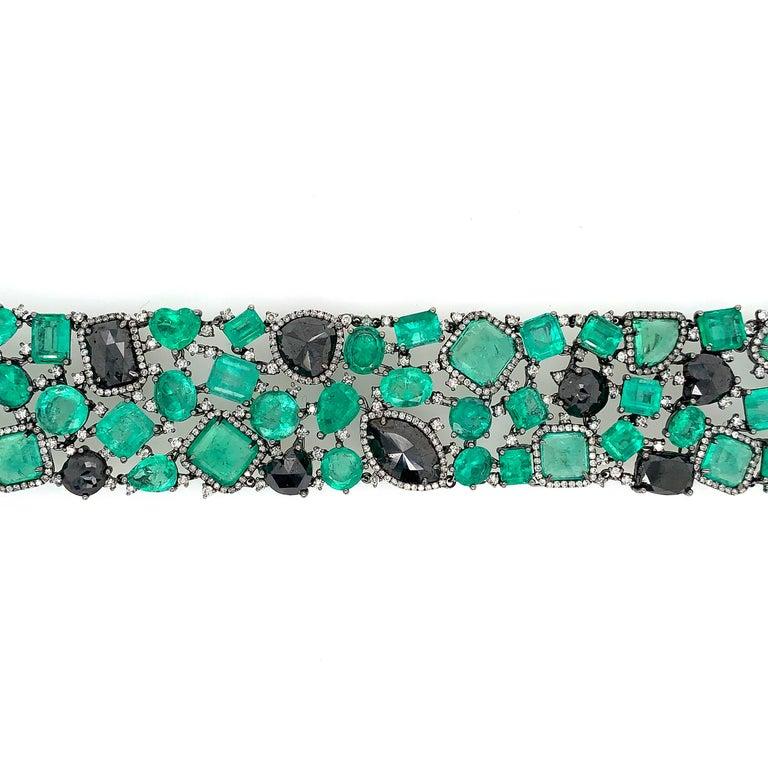 Contemporary Emerald and Black Diamond Bracelet For Sale