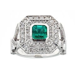 2.45 TCW Radiant Cut Emerald 1 TCW Double Diamond Frame 14 kt White Gold Ring