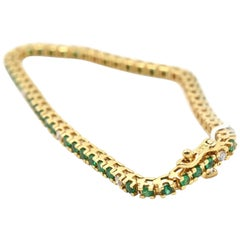 Emerald and Diamond 18 Karat Yellow Gold Tennis Bracelet