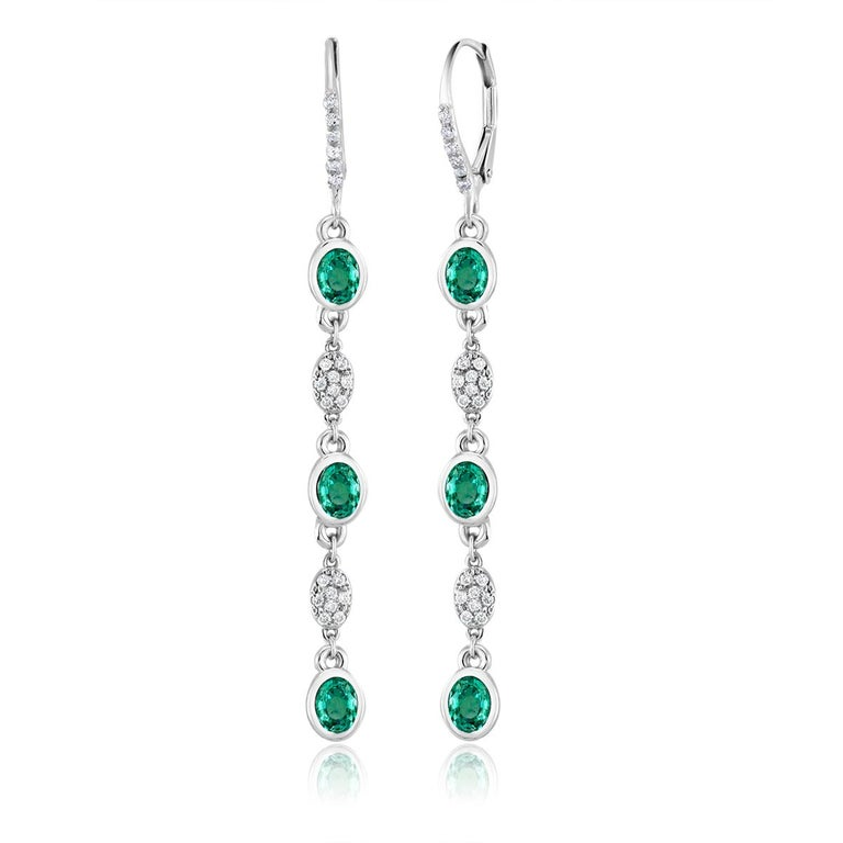 Contemporary Emerald and Diamond Bezel Set Hoop Earrings For Sale