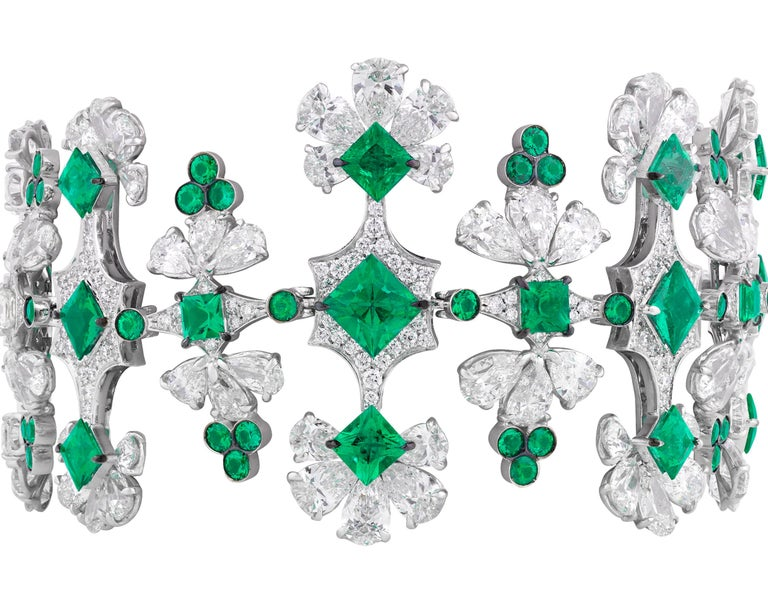An array of round and pear-shaped diamonds are joined by verdant emeralds in this one-of-a-kind Italian bracelet. The highly unique design incorporates approximately 41.98 carats of brilliant white diamonds with 13.74 total carats of emeralds, all