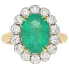 Emerald and Diamond Cluster Engagement Cocktail Ring in 18 Karat Gold