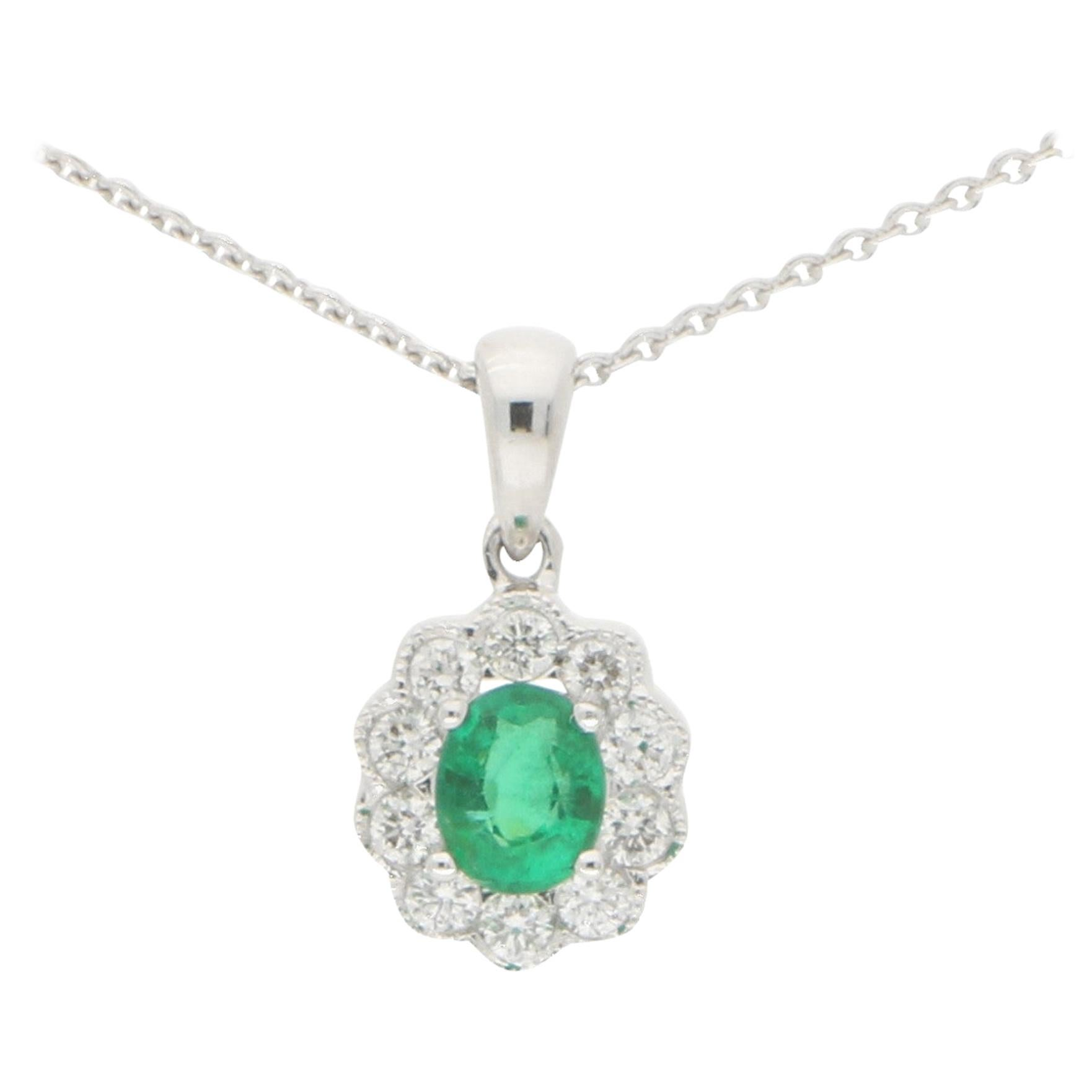 Emerald and Diamond Cluster Pendant Set in 18 Karat White Gold