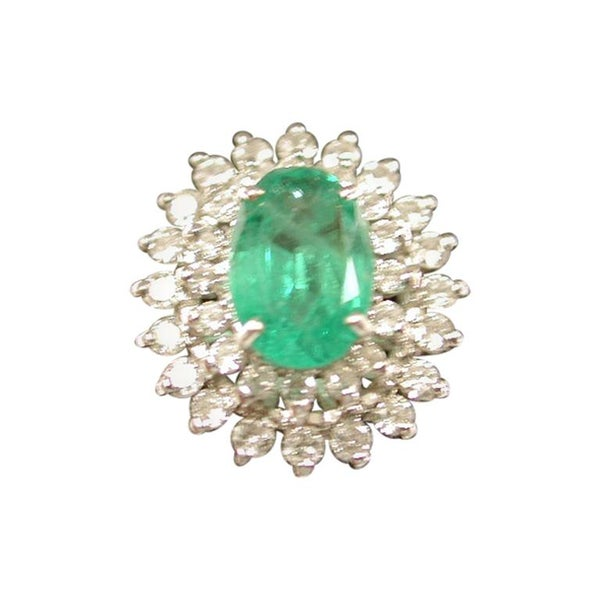 Emerald and Diamond Cluster Ring Mounted in 18 Carat Gold, London, 1979