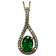 Emerald and Diamond Crossover 18 Karat Yellow & White Gold Oval Pendant Necklace