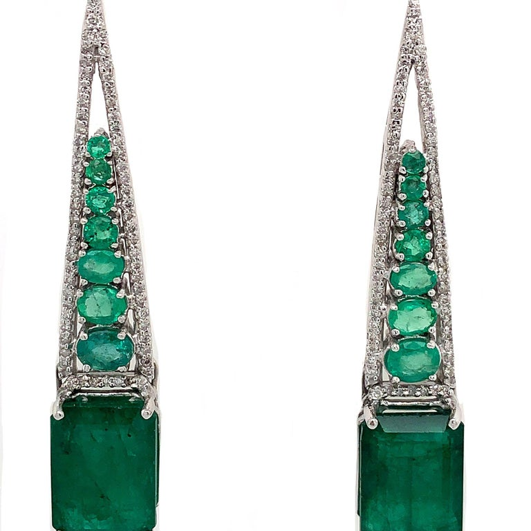 Green Lagoon Collection  Emerald and Diamond drop dangle earrings set in 18K white gold.  Emerald: 14.37ct total weight. Diamonds: 1.09ct total weight. All diamonds are G-H/SI stones.