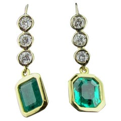Emerald and Diamond Drop Earrings in 14 Karat White and Yellow Gold