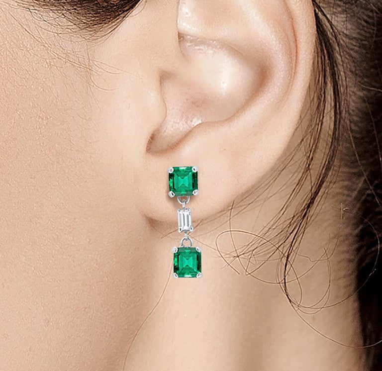 Emerald Cut Emerald and Diamond Drop Earrings Weighing 3.65 For Sale