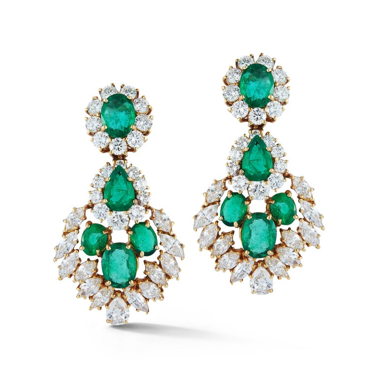 Emerald and Diamond Earrings  8 oval emeralds and 2 Pear shape emeralds app 12.80 ct  38 round diamonds app 5.27 ct and 24 marquee diamond app 5.47 ct  Made Circa 1960  14 Karat Yellow Gold