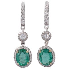 Emerald and Diamond Earrings Studded in 18 Karat White Gold