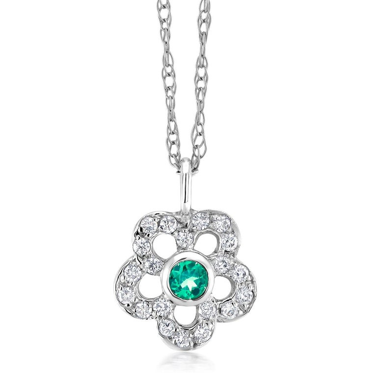 Pear Cut Emerald and Diamond Floral Charm Pendant Necklace For Sale