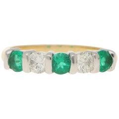 Emerald and Diamond Half Eternity Ring in 18 Karat Gold