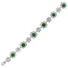 Emerald and Diamond Platinum and 18 Karat Gold Flower Bracelet