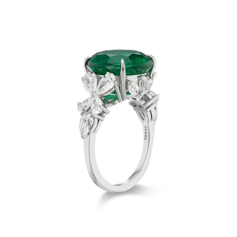 ZAMBIAN EMERALD AND DIAMOND RING BY TAKAT Pear & Marquis shape diamond leaves reminiscent of the Garden of Eden surround a lush Round shape Emerald. Item:# 03819 Setting:Platinum Color Weight:7.18 ct. of Emerald Diamond Weight:2.12 ct. of