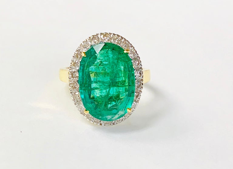 Moguldiam Inc's Emerald and diamond ring beautifully handmade in 18k yellow gold.   The details are as follows:   Emerald weight: 6.85 carat  Diamond weight: 0.77 carat  Gold weight: 4.68 grams Ring size : 6 1/2