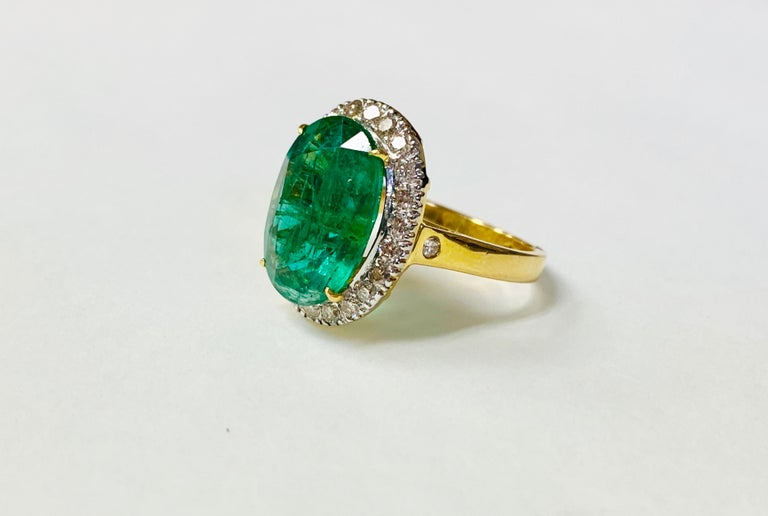 Oval Cut Emerald and Diamond Ring in 18 Karat Yellow Gold For Sale