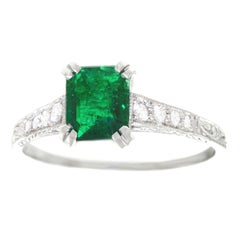 Emerald and Diamond Set Platinum Engagement Ring
