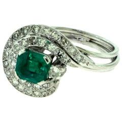 Emerald and Diamond Swirl Engagement Ring