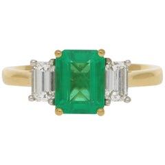 Emerald and Diamond Three-Stone Engagement Ring Set in 18 Karat Yellow Gold