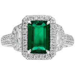 Emerald and Diamond Three-Stone Halo Diamond Ring