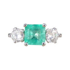 Emerald and Diamond Three-Stone Ring in Platinum