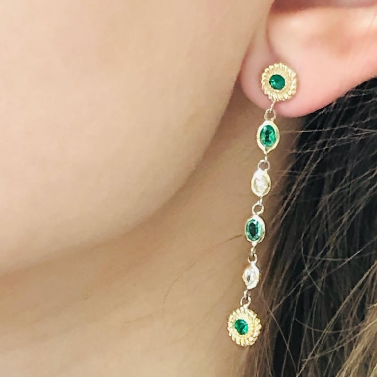 Round Cut Emerald Diamond Braided Interlacing Yellow Gold Earrings Weighing 1.77 Carats  For Sale