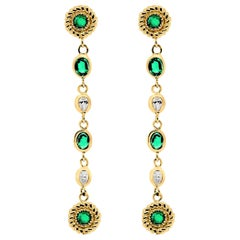 Emerald Diamond Braided Interlacing Yellow Gold Earrings Weighing 1.77 Carats