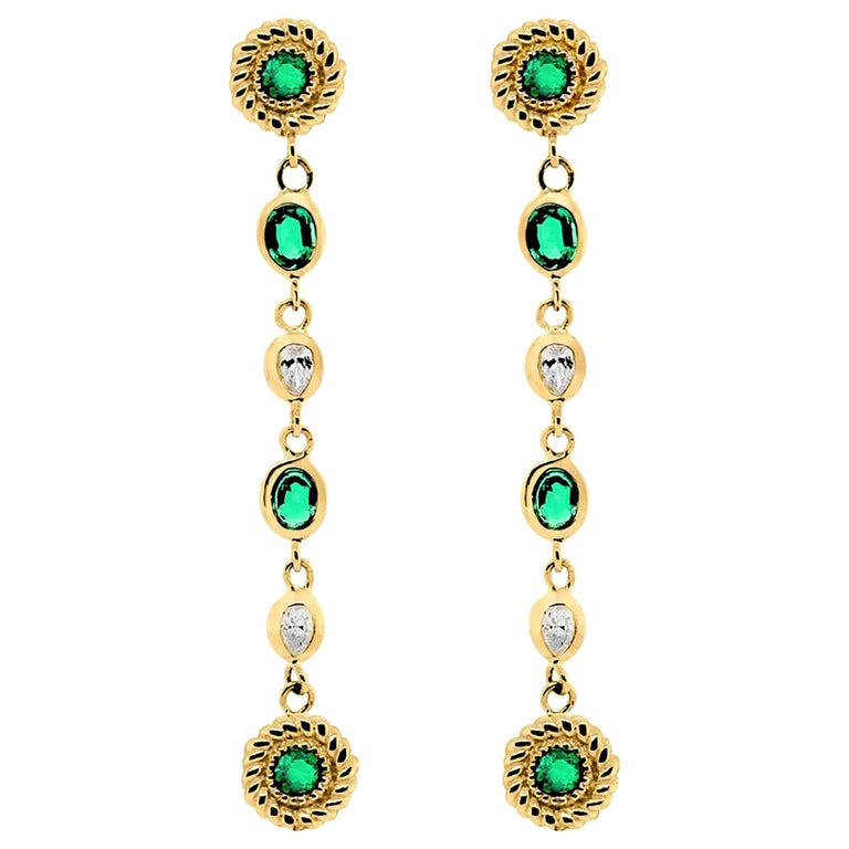 Emerald Diamond Braided Interlacing Yellow Gold Earrings Weighing 1.77 Carats  For Sale