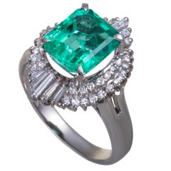 Emerald and Round and Tapered Baguette Diamond Platinum Ring