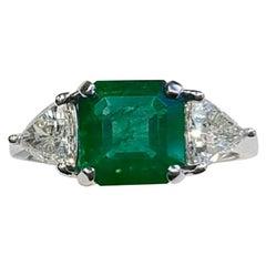 Emerald and Trillion Diamond 3-Stone Ring