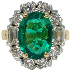 Emerald and White Diamond Engagement Ring in 18 Karat Yellow Gold