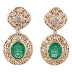 Emerald and Yellow Diamond Earring Studded in 18 Karat Matte Yellow Gold