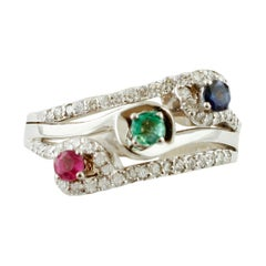 Emerald, Blue Sapphire, Ruby, Diamonds, 18 Karat Gold Modern Three Stones Ring