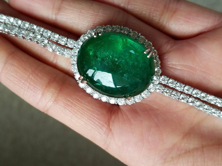 A magnificent Emerald cabochon (totalling around 45 carats) and Emerald drops necklace, with a white Diamond chain. All set in 18K  White Gold.    Stone Details:  Stone: Zambian Emerald Carat Weight: 57.70 carats  Diamond Details:  Total Carat