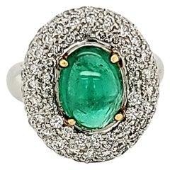 Emerald Cabochon and Diamond Halo Ring